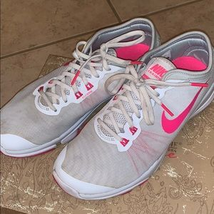 Women's pink and white Nike's